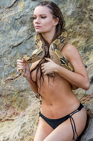 Topless Caitlin O'Connor Holding A Giant Snake