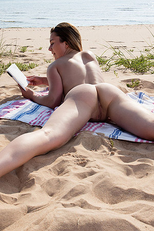 Dominika Jule Relaxes On The Sand